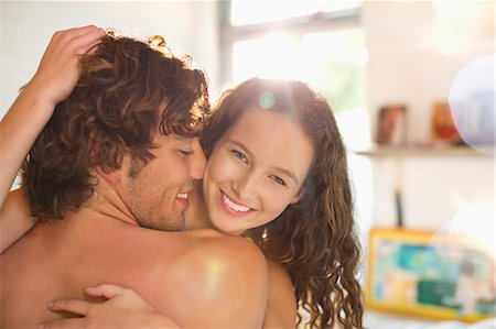romance - Nude couple hugging in bedroom Stock Photo - Premium Royalty-Free, Code: 6113-06908528