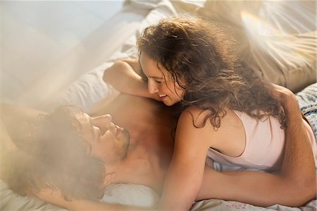Couple relaxing together in bed Stock Photo - Premium Royalty-Free, Code: 6113-06908535