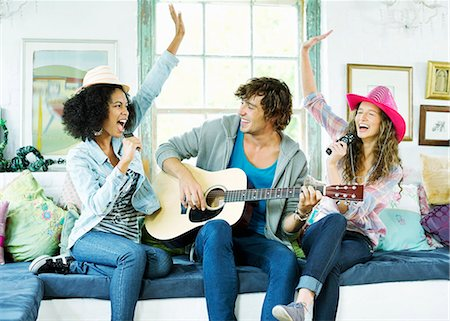 Friends singing and playing music together Stock Photo - Premium Royalty-Free, Code: 6113-06908640