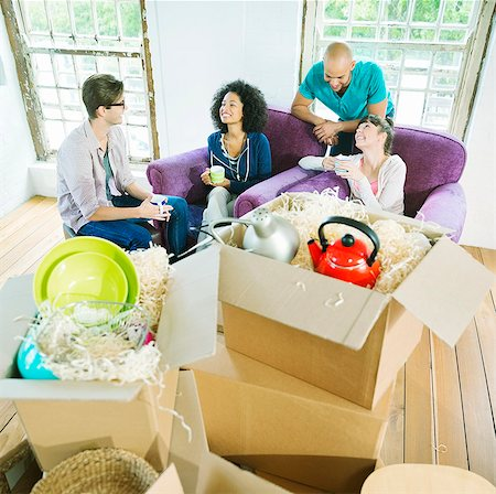 Friends relaxing in new home Stock Photo - Premium Royalty-Free, Code: 6113-06908652