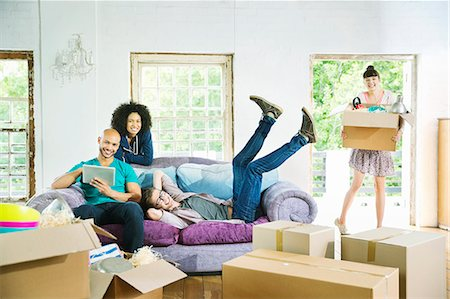 flat - Friends relaxing together in new home Stock Photo - Premium Royalty-Free, Code: 6113-06908667