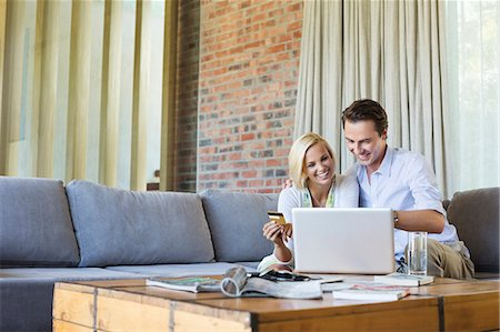 ebusiness - Couple shopping online on sofa Stock Photo - Premium Royalty-Free, Code: 6113-06908673