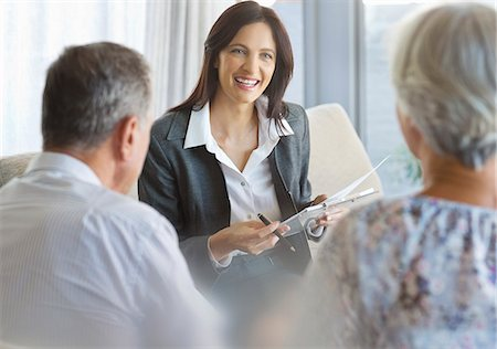 finance - Financial advisor talking to clients in office Stock Photo - Premium Royalty-Free, Code: 6113-06908680