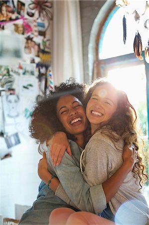 Women hugging in bedroom Stock Photo - Premium Royalty-Free, Code: 6113-06908609