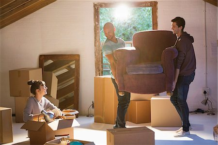 Friends moving furniture in new home Stock Photo - Premium Royalty-Free, Code: 6113-06908635