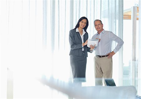 finance - Business people smiling in office Stock Photo - Premium Royalty-Free, Code: 6113-06908743