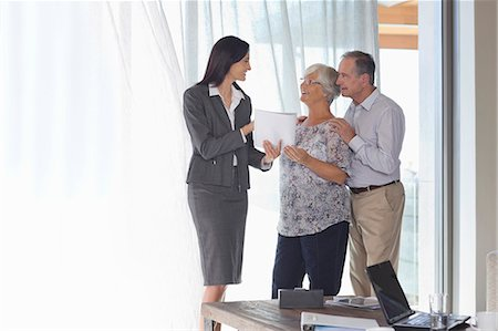 Financial advisor talking to couple in office Stock Photo - Premium Royalty-Free, Code: 6113-06908750