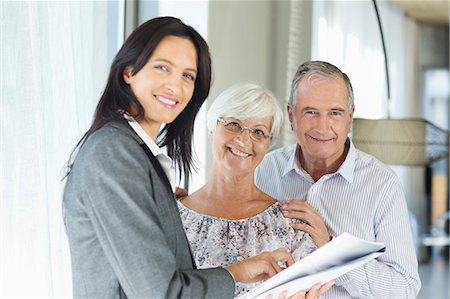 Financial advisor talking to couple indoors Stock Photo - Premium Royalty-Free, Code: 6113-06908759