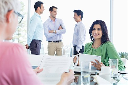 Business women talking in meeting Stock Photo - Premium Royalty-Free, Code: 6113-06908891