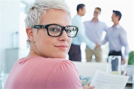 Businesswoman smiling in office Stock Photo - Premium Royalty-Free, Code: 6113-06908895
