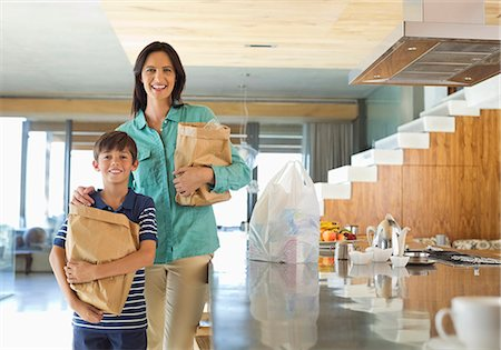 preteen touch - Mother and son holding groceries in kitchen Stock Photo - Premium Royalty-Free, Code: 6113-06908833