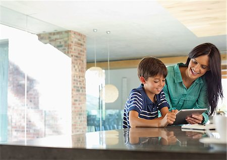 preteen family - Mother and son using tablet computer in kitchen Stock Photo - Premium Royalty-Free, Code: 6113-06908835