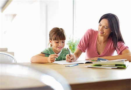 draw - Mother helping daughter with homework Stock Photo - Premium Royalty-Free, Code: 6113-06908838