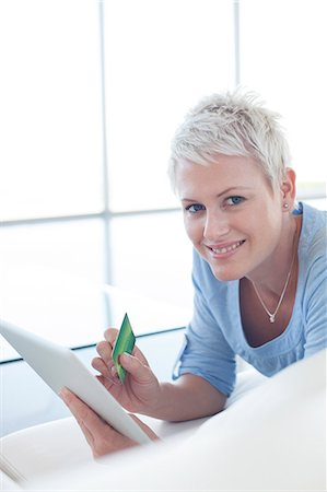 ebusiness - Woman shopping online with tablet computer Stock Photo - Premium Royalty-Free, Code: 6113-06908976