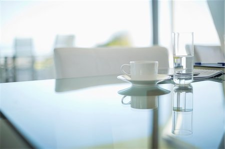 Coffee cup and water glass on meeting table Stock Photo - Premium Royalty-Free, Code: 6113-06909061