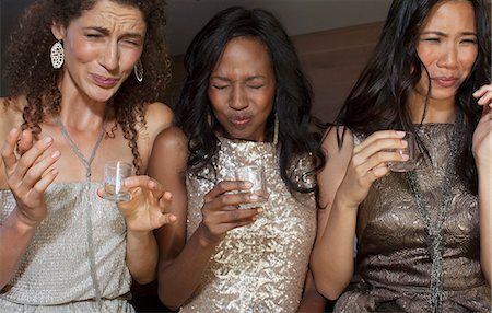 pucker - Women having shots drinks at party Stock Photo - Premium Royalty-Free, Code: 6113-06909087