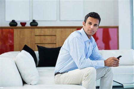 rich lifestyle - Businessman sitting on sofa Stock Photo - Premium Royalty-Free, Code: 6113-06909005