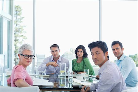Business people sitting in meeting Stock Photo - Premium Royalty-Free, Code: 6113-06909027