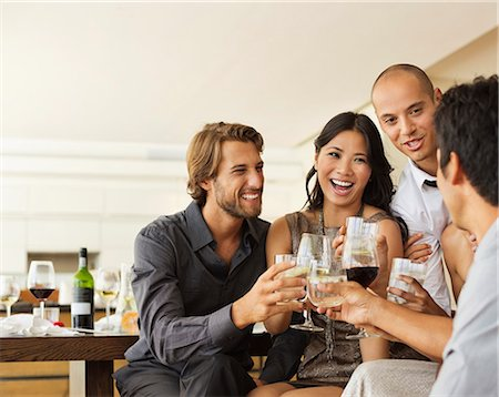 Friends toasting each other at party Stock Photo - Premium Royalty-Free, Code: 6113-06909157