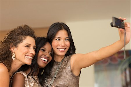 party - Women taking picture together indoors Stock Photo - Premium Royalty-Free, Code: 6113-06909154