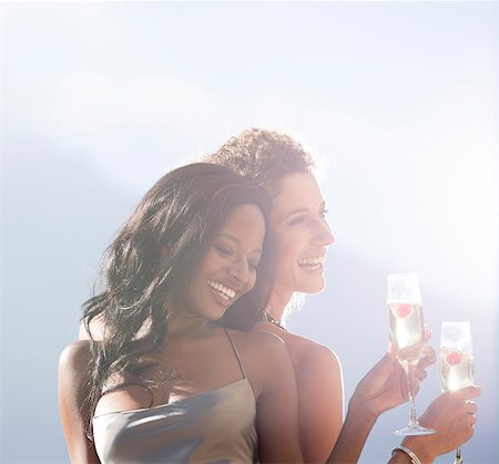 Women smiling together outdoors Stock Photo - Premium Royalty-Free, Code: 6113-06909158