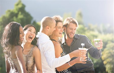 Friends laughing together at party Stock Photo - Premium Royalty-Free, Code: 6113-06909160