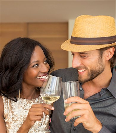 Couple toasting each other indoors Stock Photo - Premium Royalty-Free, Code: 6113-06909167