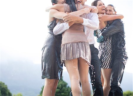 Friends in wet clothes hugging outdoors Stock Photo - Premium Royalty-Free, Code: 6113-06909165