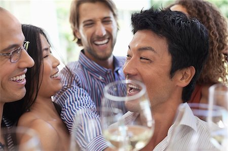 Friends toasting each other at party Stock Photo - Premium Royalty-Free, Code: 6113-06909169