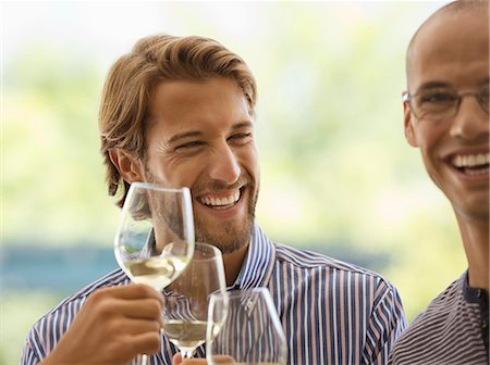 self indulgence - Men drinking wine together indoors Stock Photo - Premium Royalty-Free, Code: 6113-06909171