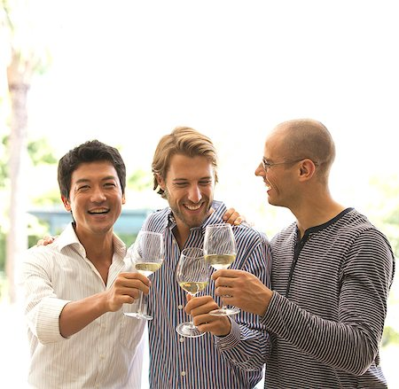 Men toasting each other with wine Foto de stock - Sin royalties Premium, Código: 6113-06909179