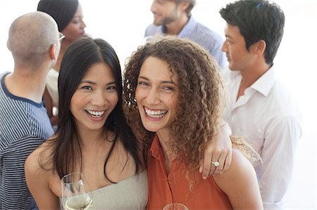 Women smiling together at party Stock Photo - Premium Royalty-Free, Code: 6113-06909108
