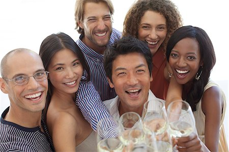 Friends toasting each other at party Stock Photo - Premium Royalty-Free, Code: 6113-06909111