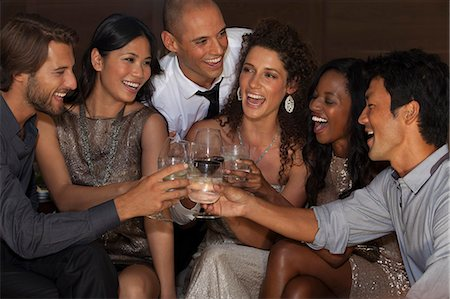 Friends toasting each other at party Stock Photo - Premium Royalty-Free, Code: 6113-06909119