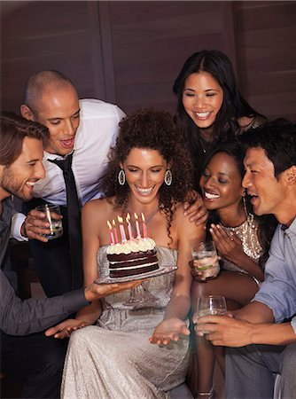 Friends celebrating birthday Stock Photo - Premium Royalty-Free, Code: 6113-06909131