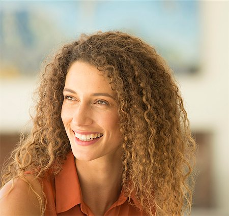 portrait looking away - Close up of woman's smiling face Stock Photo - Premium Royalty-Free, Code: 6113-06909273