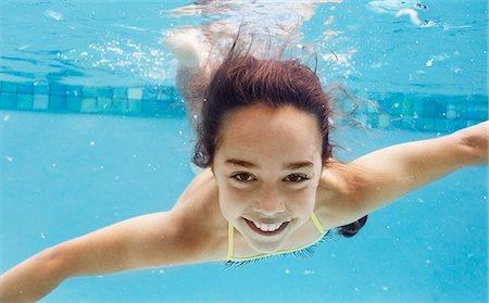 Girl swimming in pool Stock Photo - Premium Royalty-Free, Code: 6113-06909347