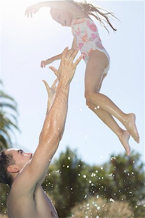 swimming pool water - Father and daughter playing in swimming pool Stock Photo - Premium Royalty-Free, Code: 6113-06909348