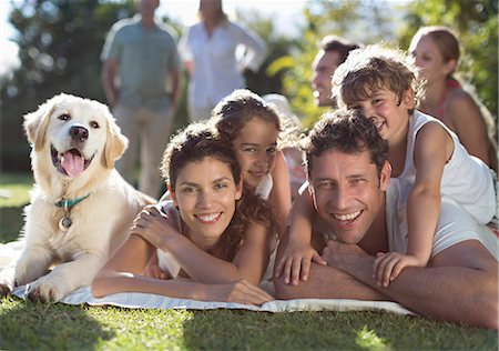 dog and woman and love - Family relaxing in backyard Stock Photo - Premium Royalty-Free, Code: 6113-06909354
