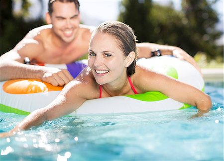 swimming - Couple relaxing in swimming pool Stock Photo - Premium Royalty-Free, Code: 6113-06909383