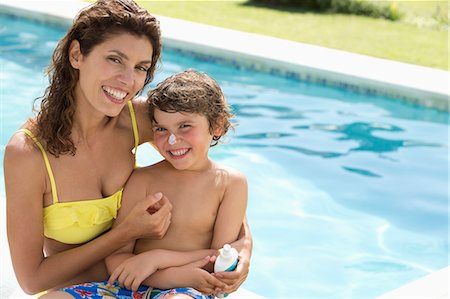 prevention - Mother applying moisturizer to son's nose Stock Photo - Premium Royalty-Free, Code: 6113-06909385