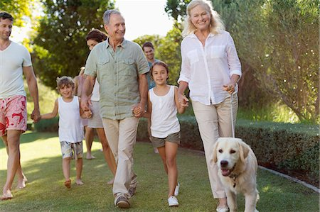 dog and woman and love - Family walking together in park Stock Photo - Premium Royalty-Free, Code: 6113-06909391