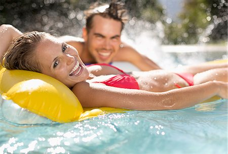 swimming pool water - Couple relaxing in swimming pool Stock Photo - Premium Royalty-Free, Code: 6113-06909302