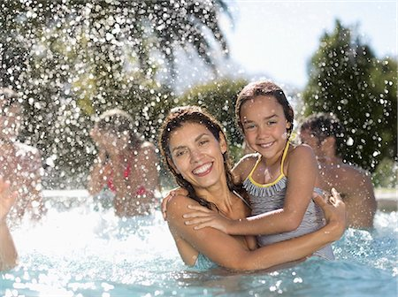 swimming pool water - Mother and daughter in swimming pool Stock Photo - Premium Royalty-Free, Code: 6113-06909306