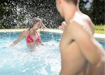 swimming pool water - Couple playing in swimming pool Stock Photo - Premium Royalty-Free, Code: 6113-06909312