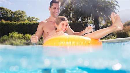 Father and son playing in swimming pool Stock Photo - Premium Royalty-Free, Code: 6113-06909315