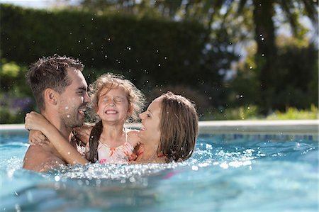 Family playing in swimming pool Stock Photo - Premium Royalty-Free, Code: 6113-06909320