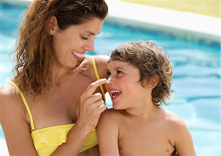 prevention - Mother applying sunscreen to son's face Stock Photo - Premium Royalty-Free, Code: 6113-06909321