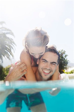 pool - Couple playing in swimming pool Stock Photo - Premium Royalty-Free, Code: 6113-06909322