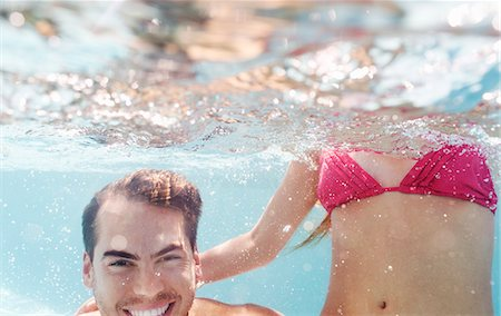 swimming - Couple playing in swimming pool Stock Photo - Premium Royalty-Free, Code: 6113-06909324